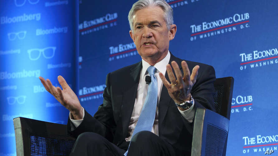 Federal Reserve Board Chair Jerome Powell talks with Carlyle Group co-CEO David Rubenstein during the Economic Club of Washington luncheon, in Washington, Jan. 10, 2019.