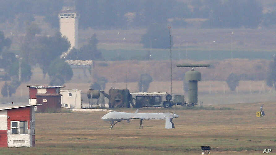 An unmanned aerial vehicle maneuvers on the runway after it landed at the Incirlik Air Base, on the outskirts of the city of Adana, southern Turkey, July 30, 2015.