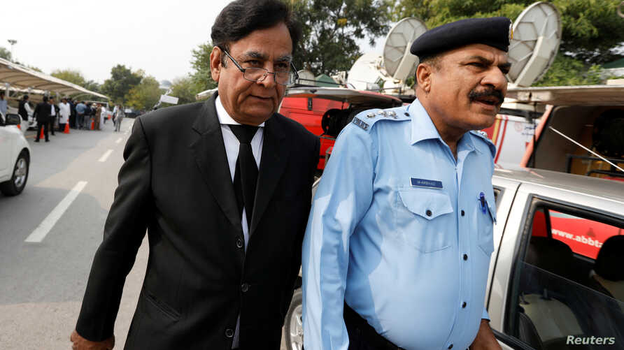 FILE - SaifulMulook, left, the lawyer for  a Christian wo