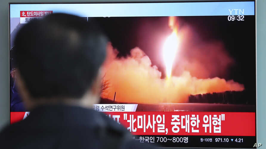 A man watches a TV screen showing a local news program reporting with a file footage of North Korea's missile launch, at the Seoul Railway Station in Seoul, South Korea, Nov. 29, 2017.