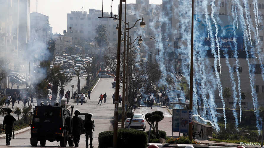 Israeli forces fire tear gas canisters at Palestinian protesters during clashes near the Jewish settlement of Beit El, in the Israeli-occupied West Bank March 20, 2019.