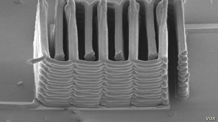 A research team from Harvard University and the University of Illinois at Urbana-Champaign has demonstrated the ability to 3D print a battery.  This image shows the interlaced stack of electrodes that were printed layer by layer to create the working