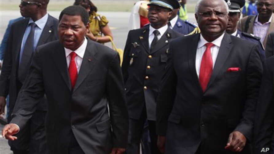 Benin President Boni Yayi, left, walks with Sierra Leone President, Ernest Bai Koroma, on arrival at the airport in Abidjan, Monday, Jan. 3, 2011. African leaders returned to Ivory Coast on Monday in their second visit in a week as they stepped up pr