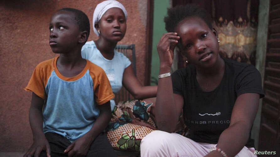 Refugees from the Malian town of Gao, which is now under the control of Islamist forces, pose at a private accommodation in the West African country's capital Bamako September 8, 2012.