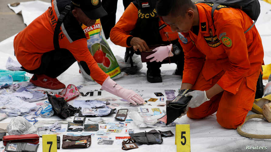 Rescue workers lay out recovered belongings believed to be from the crashed Lion Air flight JT610 at Tanjung Priok port in Jakarta, Indonesia, October 30, 2018.