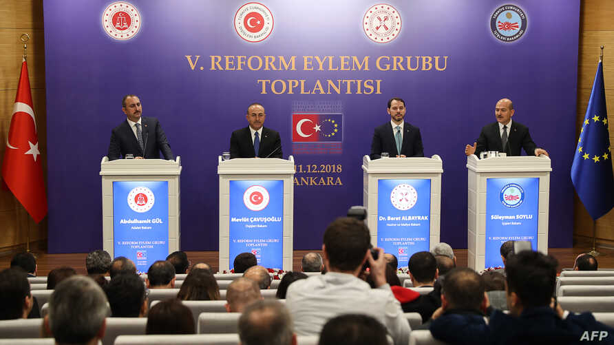 From left, Turkey's Justice Minister Abdulhamit Gul, Turkey's Foreign Minister Mevlut Cavusoglu, Turkey's Treasury and Finance Minister Berat Albayrak and Turkey's Interior Minister Suleyman Soylu hold a press conference after a meeting of the Reform