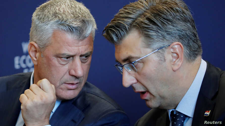 Hashim Thaci, president of Kosovo, left, talks with Andrej Plenkovic, prime minister of Croatia, during a news conference after the Strategic Dialogue of the Western Balkans meeting at the World Economic Forum (WEF) in Cologny, near Geneva, Switzerla