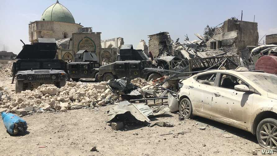 Much of the Old City of Mosul is in ruins as Iraqi forces battle Islamic State militants for the city. The destroyed al-Nuri mosque, shown in the background, shows the level of destruction in the city, July 1, 2017.