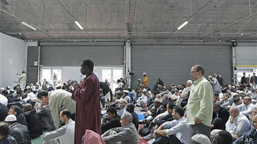 French Muslims attend a mass prayer at a prayer hall in a unused former fire station, Paris, September 16, 2011.