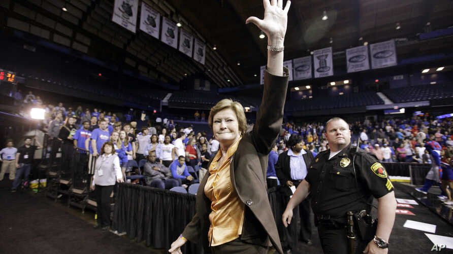 FILE- Tennessee head coach Pat Summitt waves as she leaves the court after Tennessee defeated DePaul, 63-48, in an NCAA tournament second-round women's college basketball game in Rosemont, Illinois, March 19, 2012.