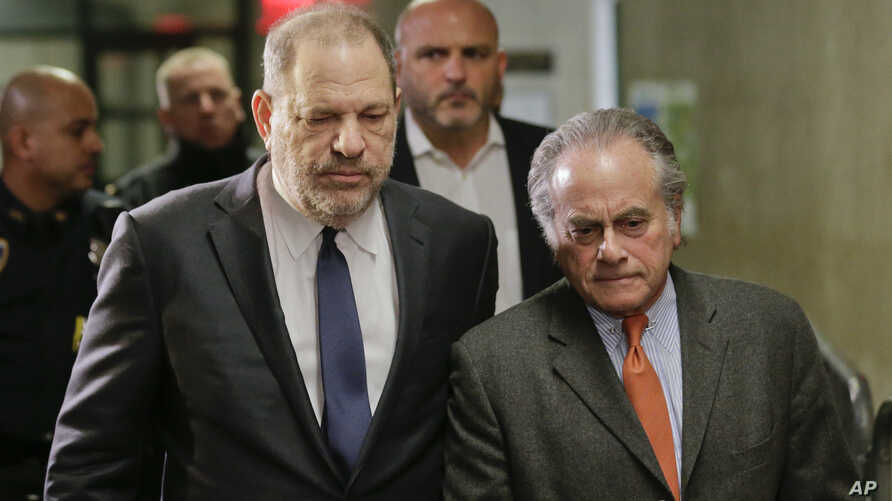 FILE- Harvey Weinstein, left, arrives at New York Supreme Court with his attorney Benjamin Brafman in New York, Dec. 20, 2018. Brafman filed court papers on Thursday, Jan. 17, 2019, asking to withdraw as Weinstein's lawyer.