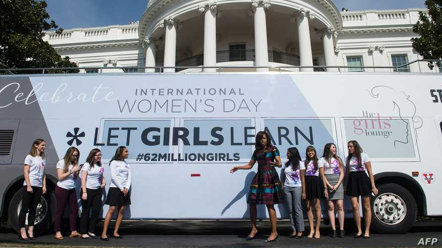 U.S. first lady Michelle Obama poses with young female students in front of the White House before an event to mark International Women's Day, as part of the first lady's Let Girls Learn initiative, in Washington, D.C., March 8, 2016.