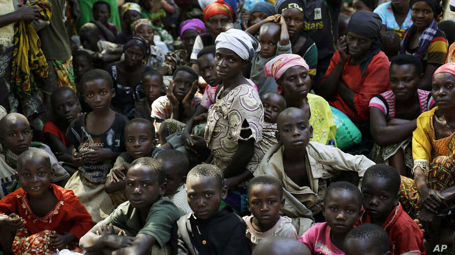 Refugees who fled Burundi's violence and political tension wait to board a ship freighted by the UN, at Kagunga on Lake Tanganyika, Tanzania, May 23, 2015 to be taken to the port city of Kigoma.