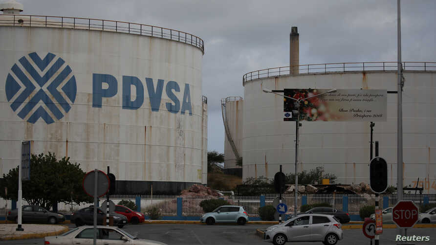 The logo of Venezuelan oil company PDVSA is seen on a tank at Isla refinery in Willemstad on the island of Curacao, April 22, 2018.