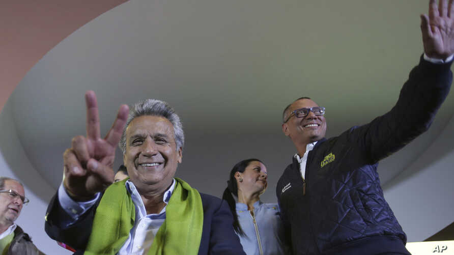 Alianza PAIS's presidential candidate Lenin Moreno, left, and his running mate Jorge Glas smile at the end of the day of the presidential election, in Quito, Ecuador, April 2, 2017.