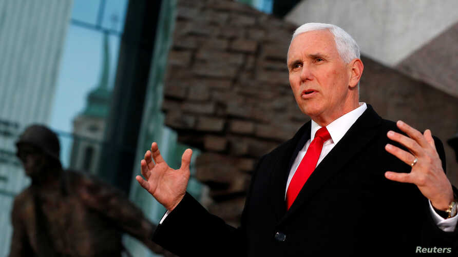 U.S. Vice President Mike Pence speaks next to the Warsaw Uprising Monument in Warsaw, Poland, Feb. 14, 2019.