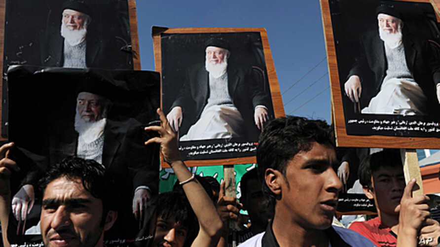 Supporters of the slain former Afghan president Burhanuddin Rabbani shout slogans and hold up his portrait during a protest against the Taliban and Pakistan in Kabul, September 27, 2011.