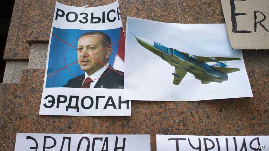 """Posters showing a portrait of Turkish President Recep Tayyip Erdogan and reading """"Wanted,""""  """"Erdogan, Turkey,"""" are left after a protest at the Turkish Embassy in Moscow, Nov. 25, 2015."""