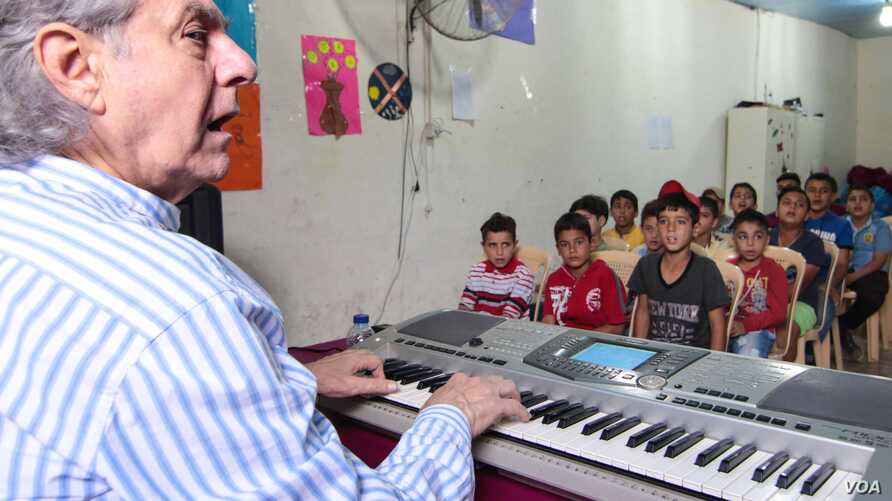 Maestro Salim Sahab with his young students at the Beyond Association center in Tripoli, Lebanon, Oct. 28, 2017.