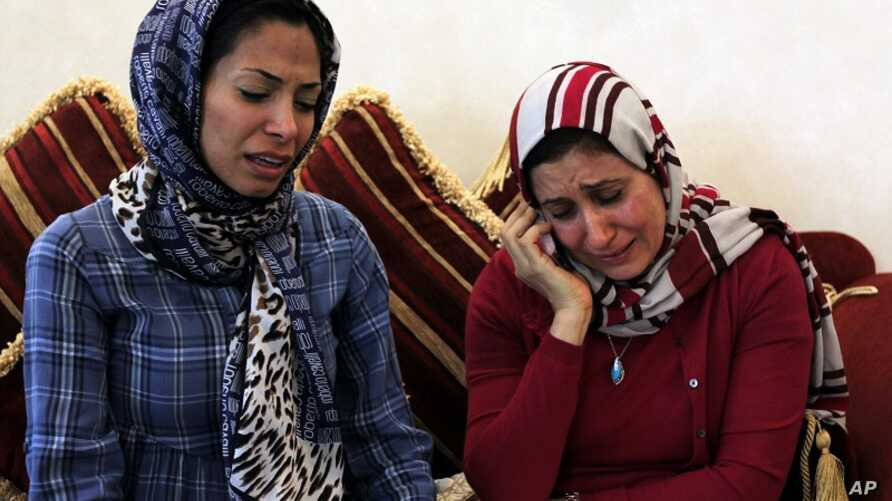 Dr. Fatima Haji, left, and Dr. Zahra al-Samak, right, react to a judge's verdict June 14, 2012, at a fellow doctor's home in Sehla, Bahrain, west of the capital Manama.