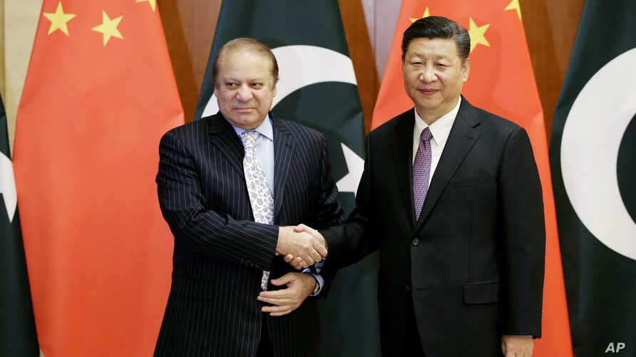 Pakistani Prime Minister Nawaz Sharif, left, shakes hands with Chinese President Xi Jinping ahead of the Belt and Road Forum in Beijing, China, May 13, 2017.