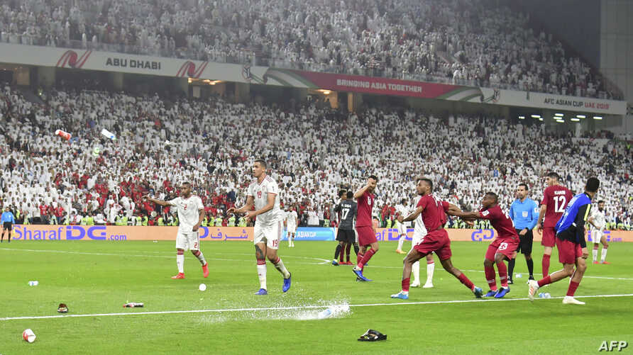 Fans throw bottles and flip-flops at the pitch during the 2019 AFC Asian Cup semi-final football match between Qatar and UAE at the Mohammed Bin Zayed Stadium in Abu Dhabi, Jan. 29, 2019.