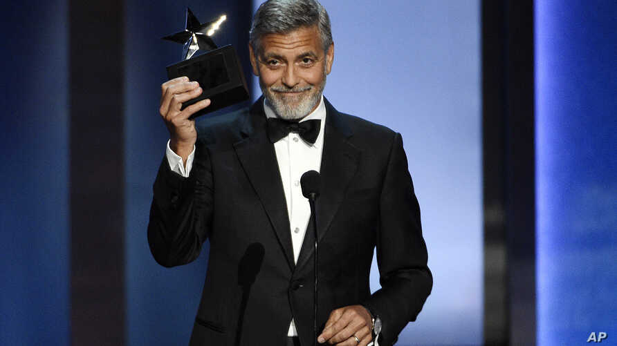 FILE - Actor-director George Clooney accepts the 46th AFI Life Achievement Award during a gala ceremony in Los Angeles, June 7, 2018.