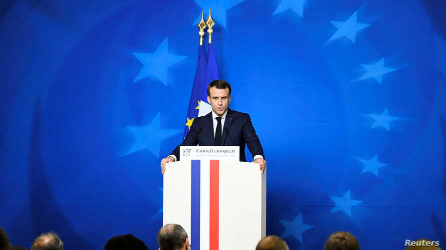 FILE - French President Emmanuel Macron attends a news conference after a European Union leaders summit in Brussels, Belgium Dec. 14, 2018.