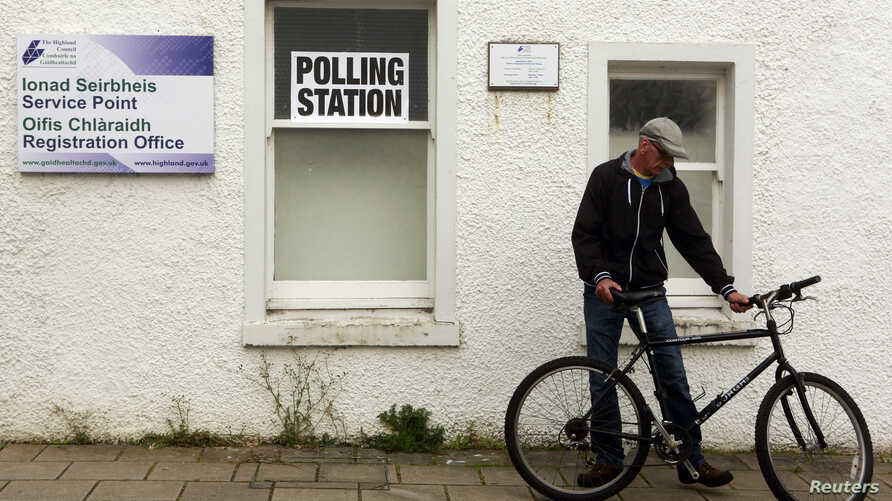 A man arrives at a polling station in Portree on the Isle of Skye, Sept. 18, 2014.