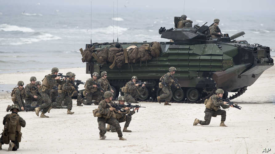 U.S. Marines with Amphibious Assault Vehicles take a part in a landing operation during  Exercise Baltops 2018 along the Baltic Sea near the Lithuania village of Nemirseta, June 4, 2018. The U.S.-led exercise features 18,000 soldiers from 19 primaril