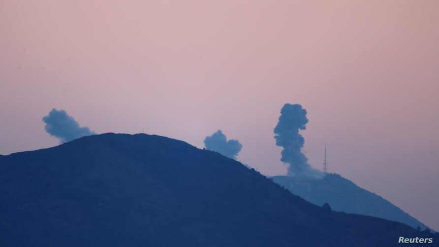 Smoke rises following airstrikes in Syria's Afrin region, as seen from near the Turkish town of Hassa, on the Turkish-Syrian border in Hatay province, Turkey, Jan. 20, 2018.