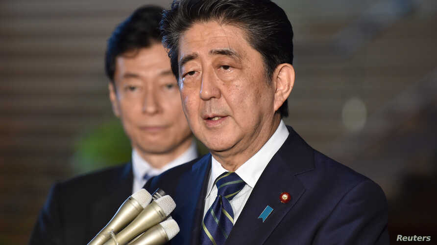 Japan's Prime Minister Shinzo Abe speaks to reporters at Abe's official residence in Tokyo, June 6, 2018, before leaving for the U.S.