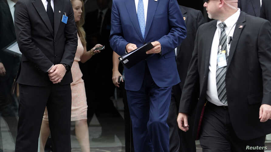 U.S. Secretary of State John Kerry leaves a meeting at a hotel in Vienna, Austria, July 14, 2014.