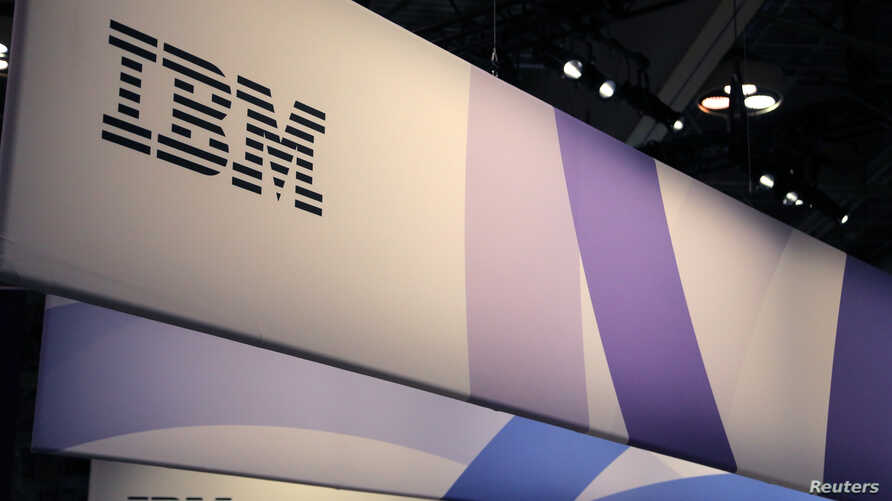 FILE - The IBM logo is seen at the SIBOS banking and financial conference in Toronto, Ontario, Canada, Oct. 19, 2017.