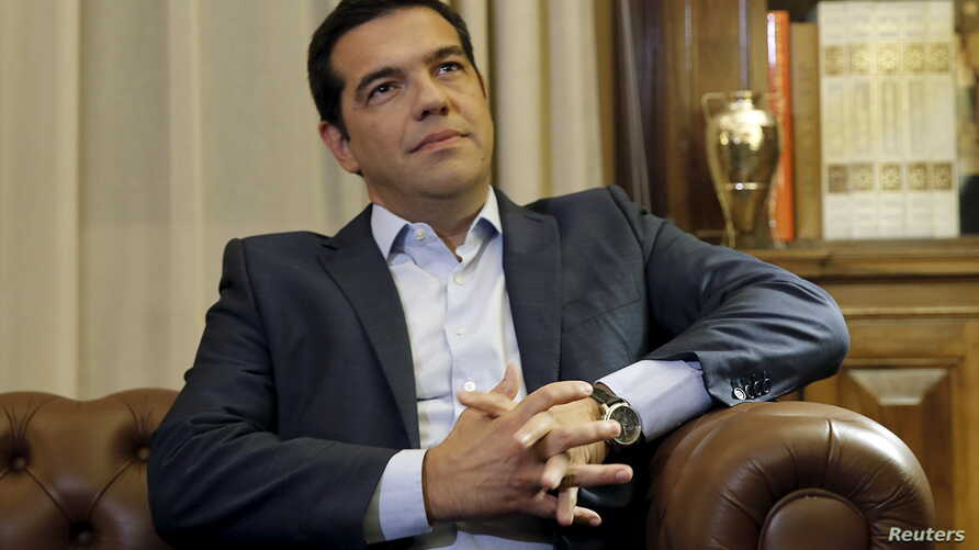 Greek Prime Minister Alexis Tsipras is received by Greece's President Prokopis Pavlopoulios (unseen) in Athens, Greece, Aug. 20, 2015.