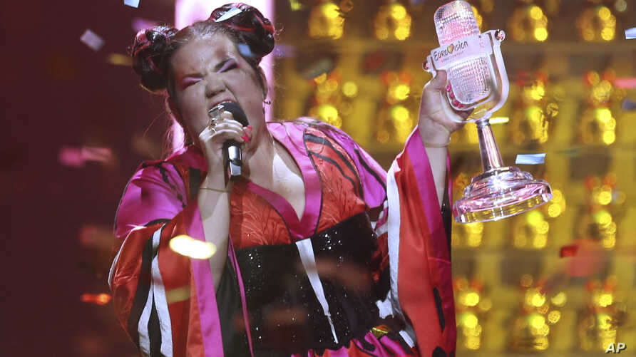 FILE - In this May 12, 2018 file photo, Netta Barzilai from Israel celebrates after winning the Eurovision song contest in Lisbon, Portugal. When the United States recognized Jerusalem as Israel's capital, Israelis hoped other countries would follow