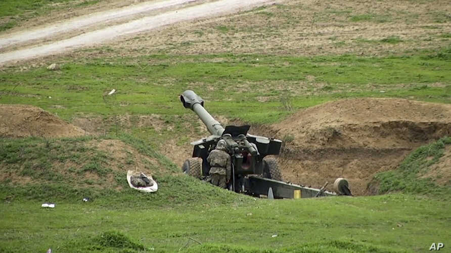 Armenian soldiers aim a howitzer, April 3, 2016, in the village of Mardakert, in the separatist region of Nagorno-Karabakh.