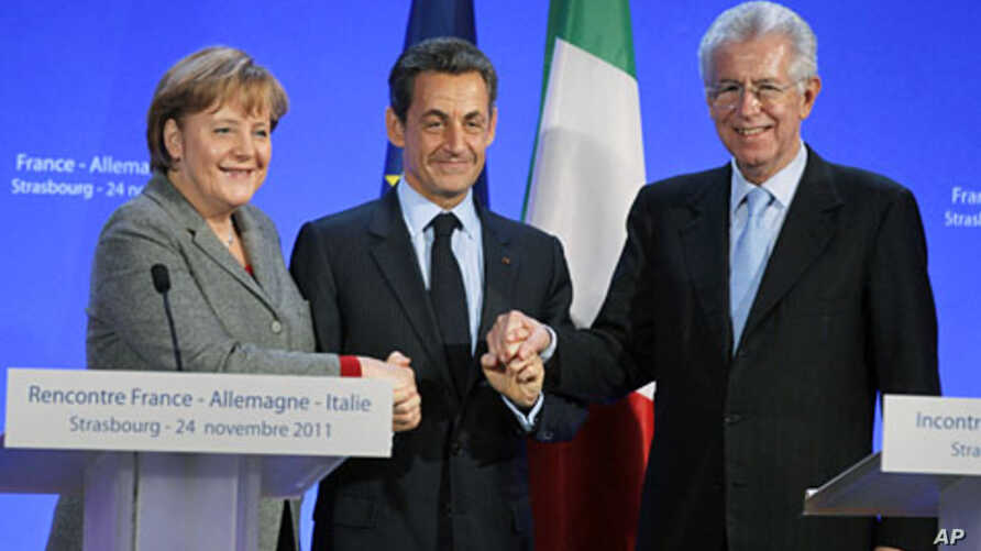 German Chancellor Angela Merkel (L), France's President Nicolas Sarkozy (C) and Italy's Prime Minister Mario Monti shake hands at the end of a news conference after a trilateral meeting on eurozone crisis in Strasbourg, eastern France, November 24, 2