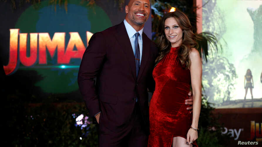 """FILE - Cast member Dwayne Johnson and Lauren Hashian pose at the premiere for """"Jumanji: Welcome to the Jungle"""" in Los Angeles, California, U.S., December 11, 2017."""