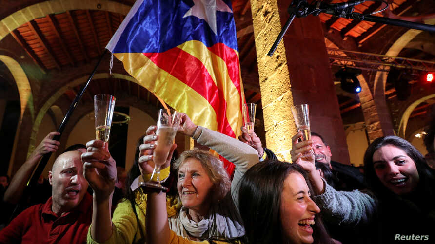 People react to results in Catalonia's regional elections at a gathering of the Catalan National Assembly in Barcelona, Spain, Dec. 21, 2017.