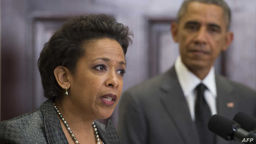 US President Barack Obama (R) looks on as his nominee for US Attorney General, Loretta Lynch (L), the US attorney in Brooklyn, NY, speaks during an event at the White House in Washington, DC, November 8, 2014.