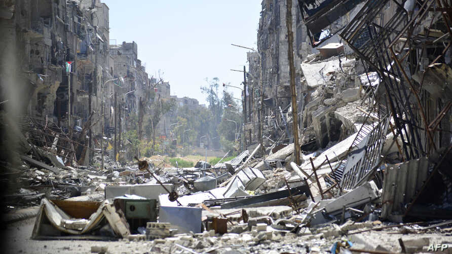TOPSHOTSA general view taken on April 6, 2015 shows destruction in Yarmouk Palestinian refugee camp in the Syrian capital, Damascus. Around 2,000 people have been evacuated from the Yarmuk Palestinian refugee camp in Damascus after the Islamic State ...