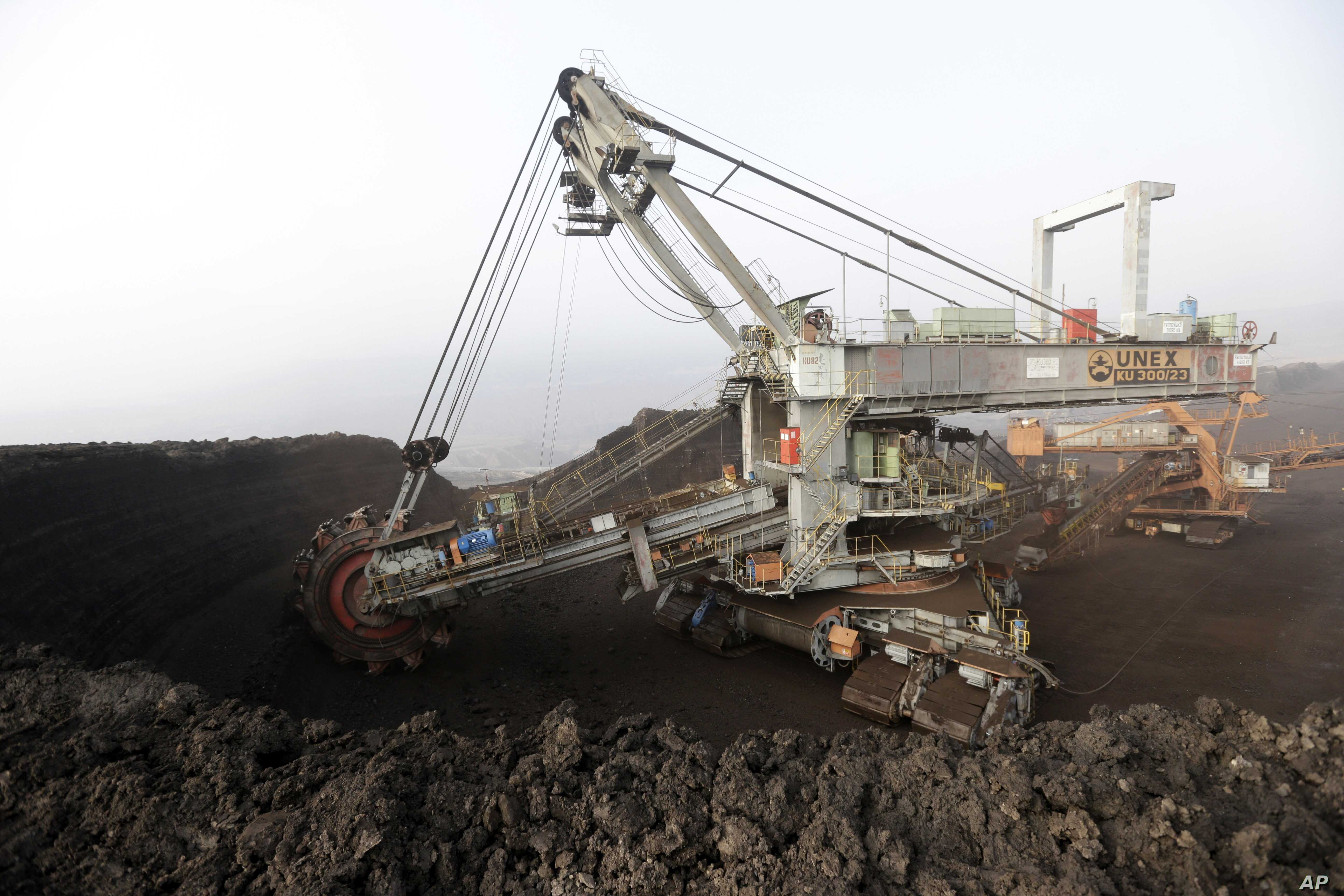 A huge excavator digs in a giant open-pit lignite mine near the Czech Republic town of Most, Nov. 6, 2015. The fossil fuel is a major source of greenhouse gases.