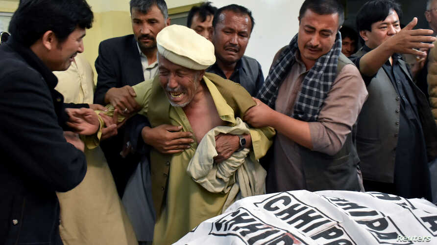 A father of a member of Hazara community, who was killed with along others sone by unidentified gunmen, mourns the death of his son at hospital in Quetta, Pakistan April 22, 2018.