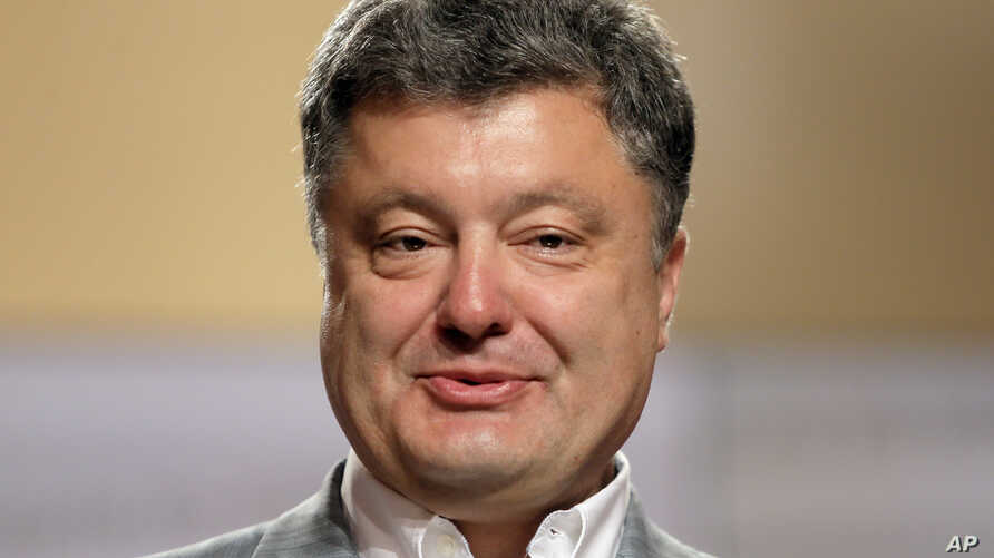 Ukrainian presidential candidate Petro Poroshenko talks, during a press conference,  in Kiev, Ukraine, Monday, May 26, 2014