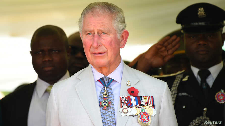 Britain's Charles, Prince of Wales stands during the honoring of the fallen heroes of the two World Wars in Abuja, Nigeria, Nov. 8, 2018.