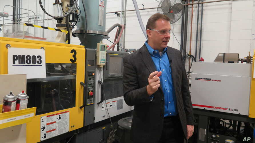 FILE - Chief financial officer Paul Buzzell explains the process of making levels, at the Johnson Level and Tool plant, in Mequon, Wisconsin, Sept. 12, 2018.