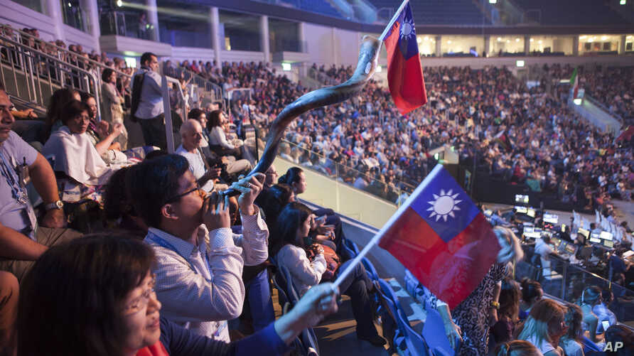 Evangelical Christians wave Taiwanese flags and another blows a shofar during a gathering in Jerusalem. Thousands of evangelical Christians from more than 80 countries descended upon Jerusalem this week to profess their love for the Jewish state, Sep
