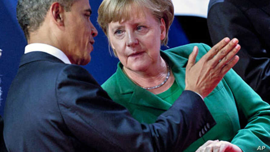 U.S. President Barack Obama and German Chancellor Angela Merkel talk at the G20 summit in Cannes, France, November 3, 2011