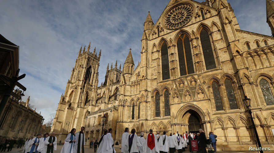 Members of the clergy enter York Minster before a service to consecrate Reverend Libby Lane as the first female bishop in the Church of England, in York, northern England, Jan. 26, 2015.